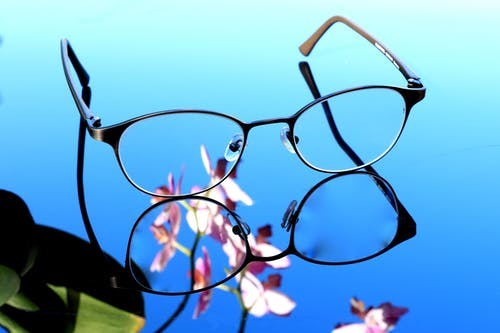 Reflective Photography of Black Framed Eyeglasses