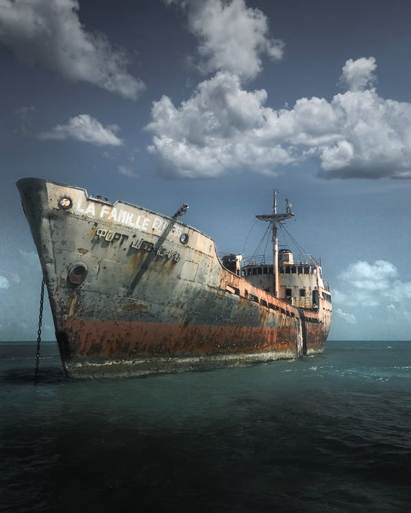 Photo of Old Ship Under Cloudy Sky