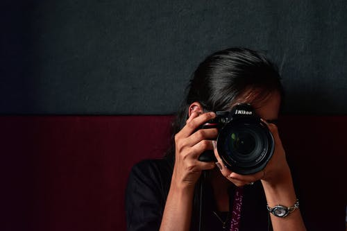 Photo of Person Using Nikon Dslr Camera