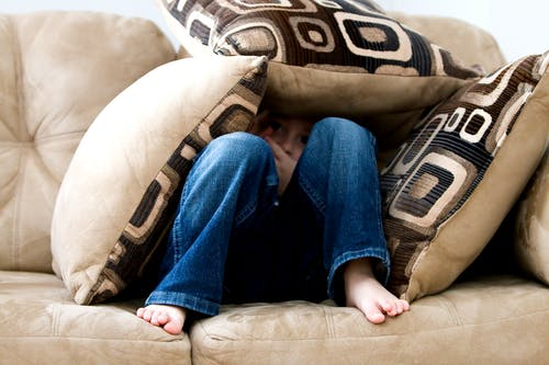 Person Sitting on Couch