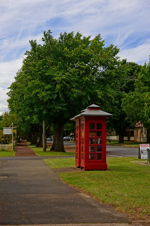 Free stock photo of cloud, green, phone booth, red