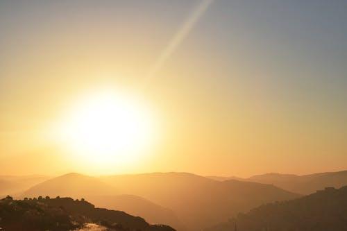 Gratis lagerfoto af skinnende, sol, solnedgang