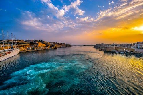 Foto stok gratis air, Fajar, kota, langit