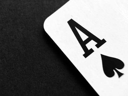 Ace of Spade Playing Card on Grey Surface