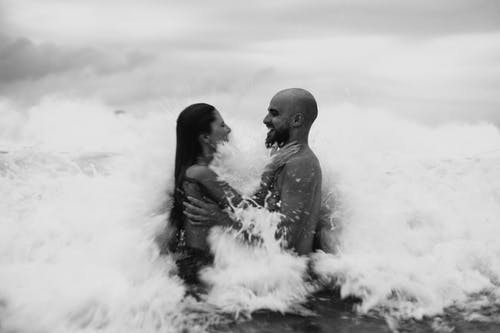 Monochrome Photo of Couple In Ocean