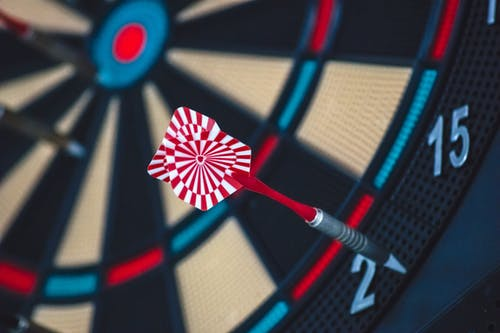 Red and White Dart on Darts Board