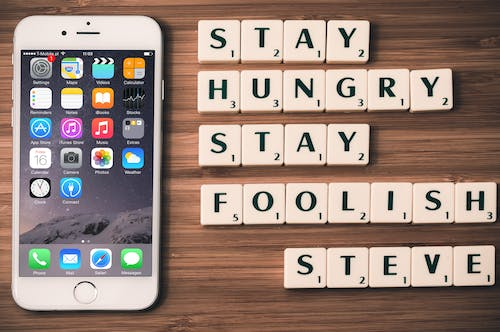 Silver Iphone 6 Near Scrabble Tiles