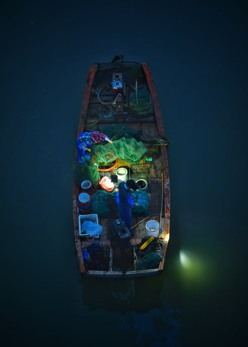 Top View Photo Of Boat During Evening