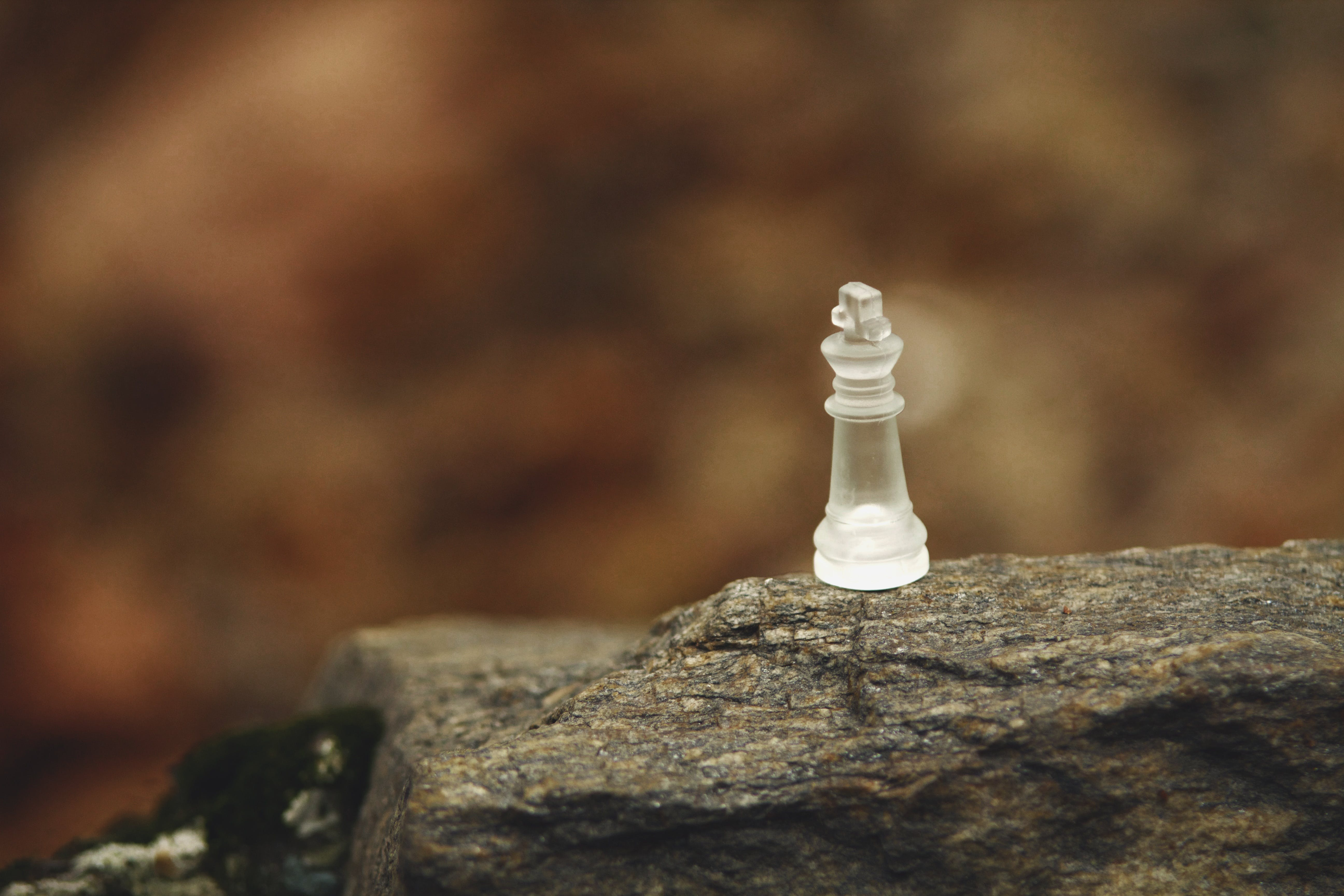Frosted Glass Bishop Chess Piece on Rock