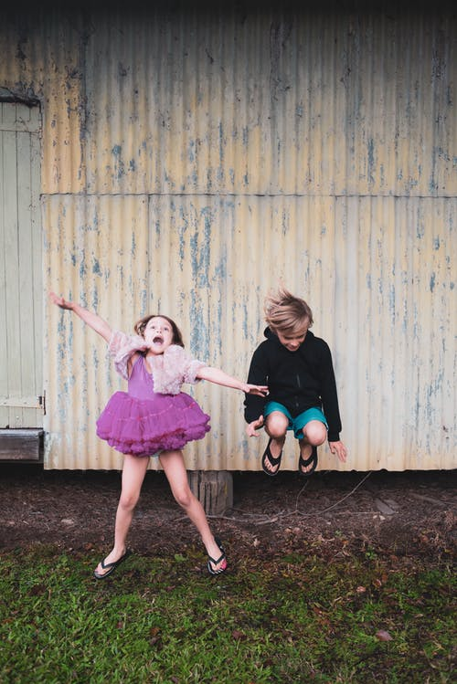 Photo Of Boy Jumping Beside Girl