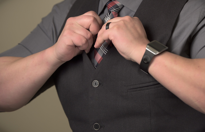 Man Fixing Necktie
