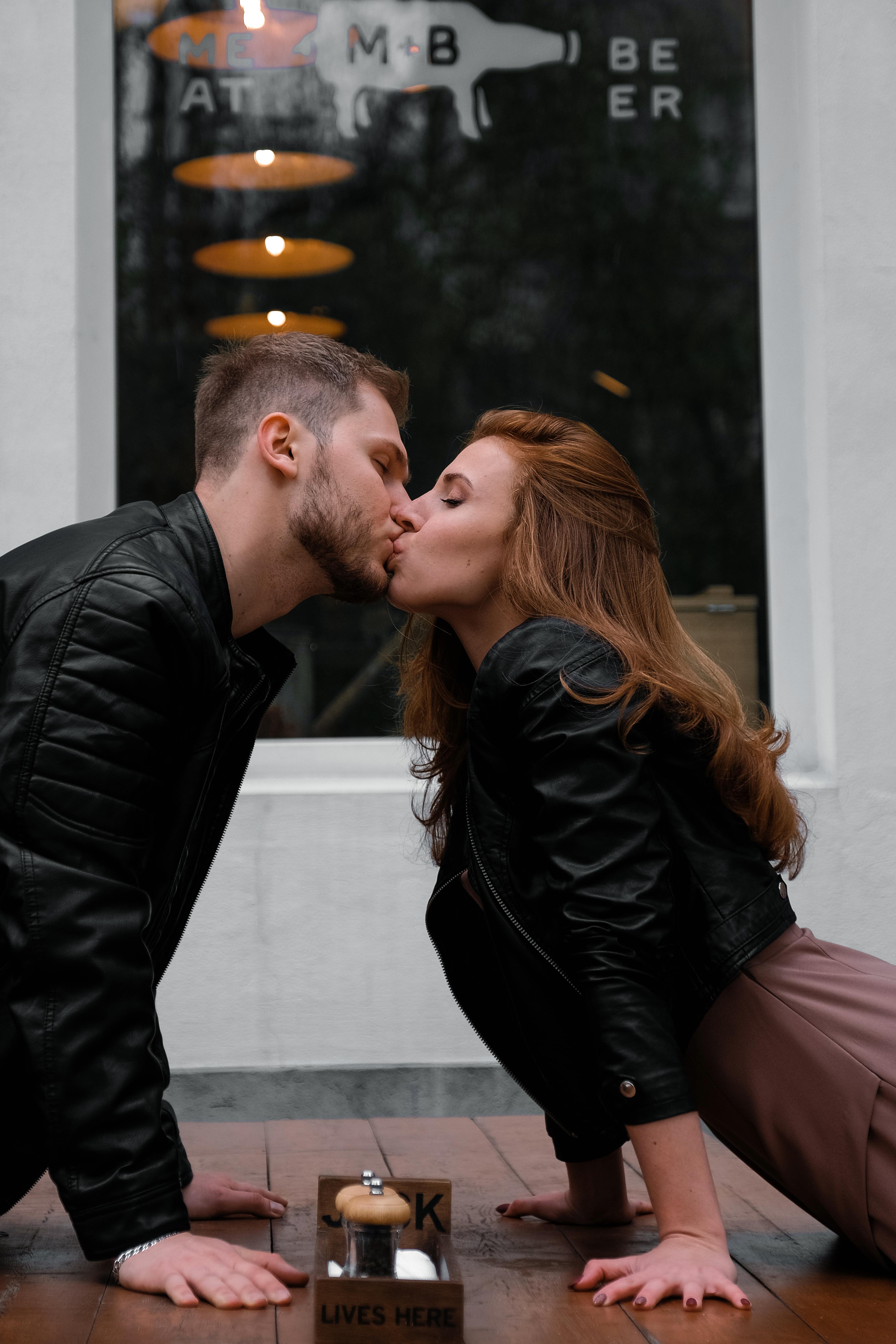 Kissing Couple Wearing Black Jackets