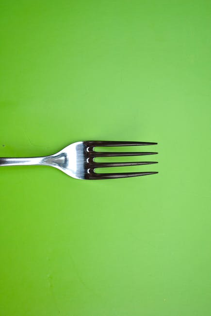 Stainless Steel Fork On Green Paper 183 Free Stock Photo