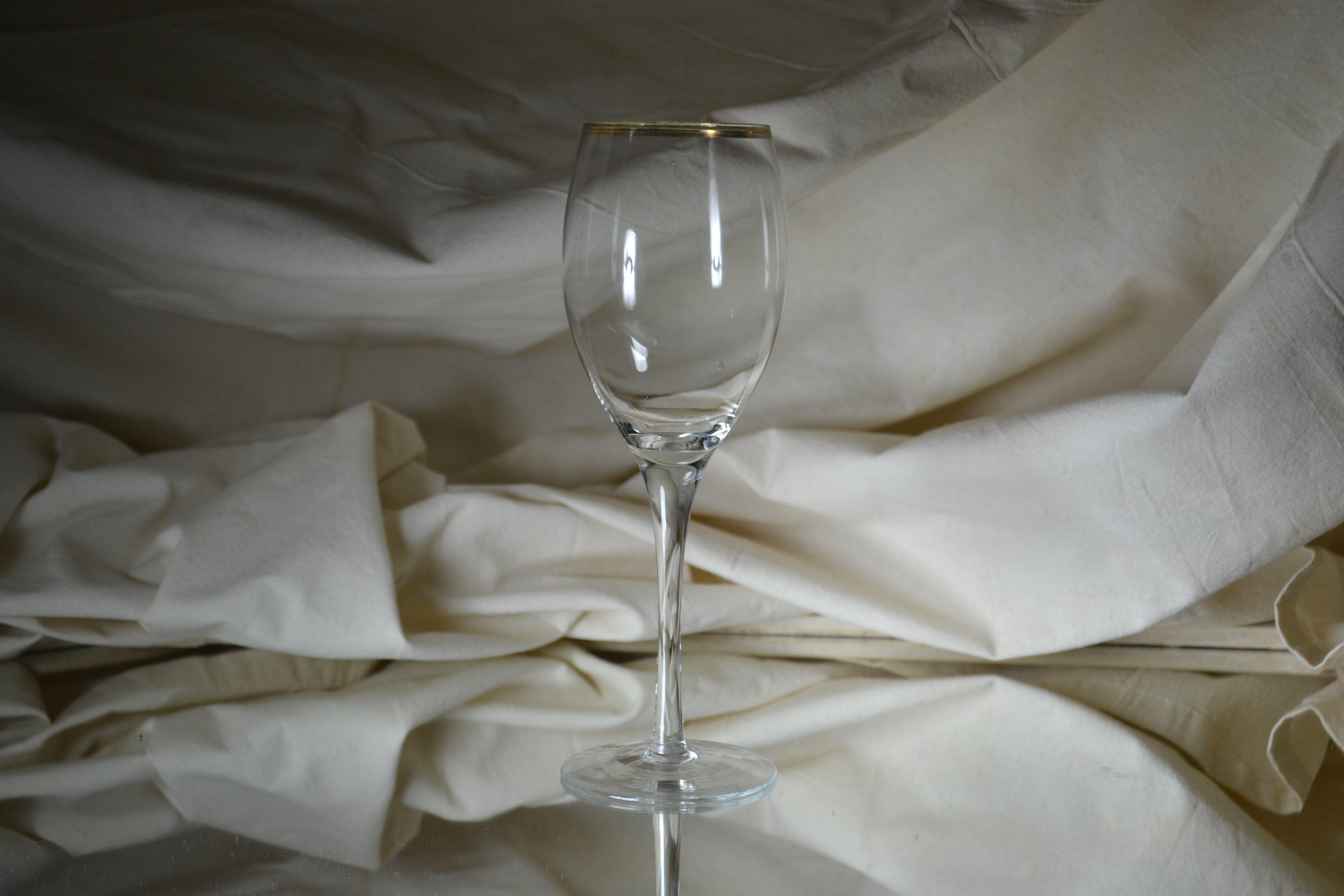 Clear Flute Glass Near White Cloth