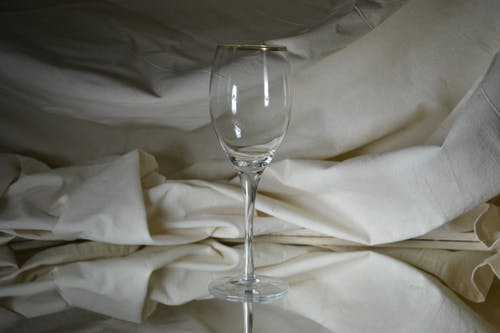 Clear Flute Glass Near White Cloth