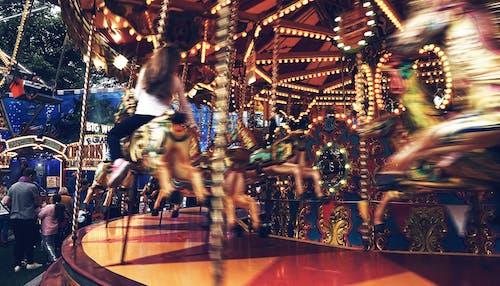 Gratis stockfoto met bewegingsonscherpte, carrousel, entertainment, familie