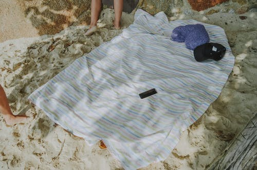 Free stock photo of beach, blanket, foot, fun
