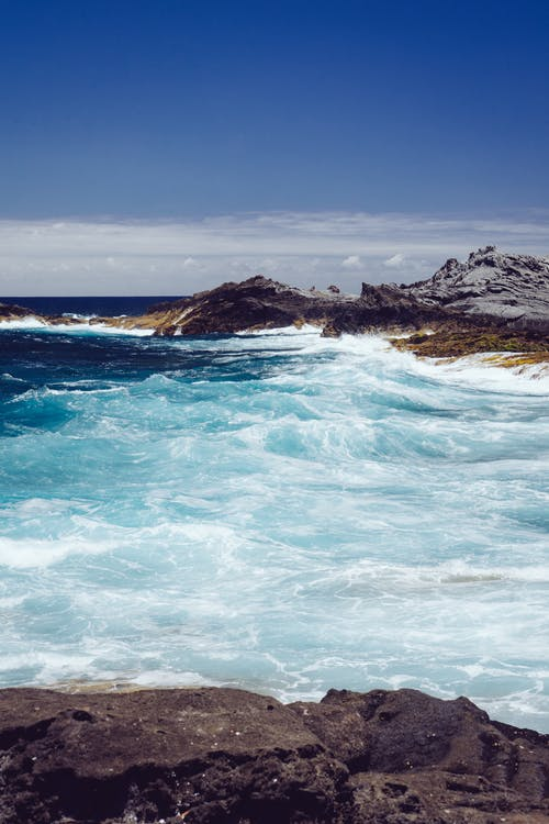 Seawaves Beside Rocks