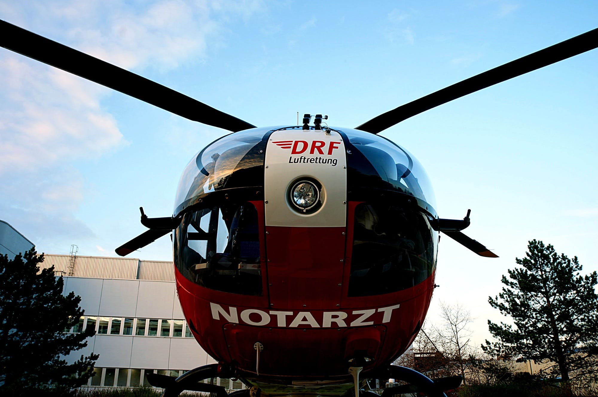 Low-angle Photography of Red and Black Notarzt Helicopter