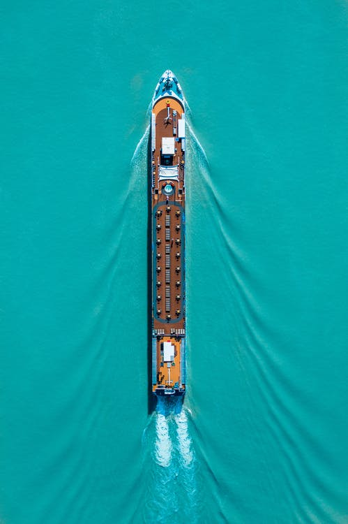 Top View Photo Of Boat On Sea