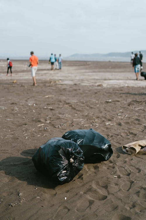 Photo Of Trash Bag On Sand