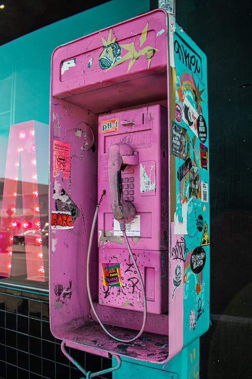 Photo of Pink and Blue Telephone Booth