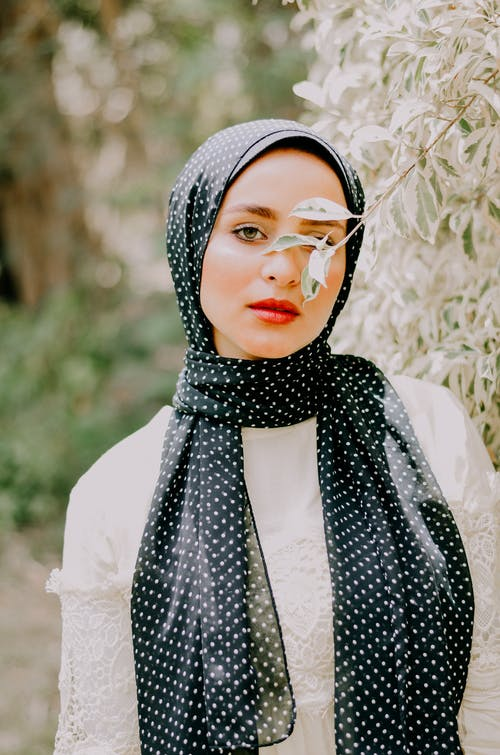 Woman Wearing White and Black Dress and Headscarf