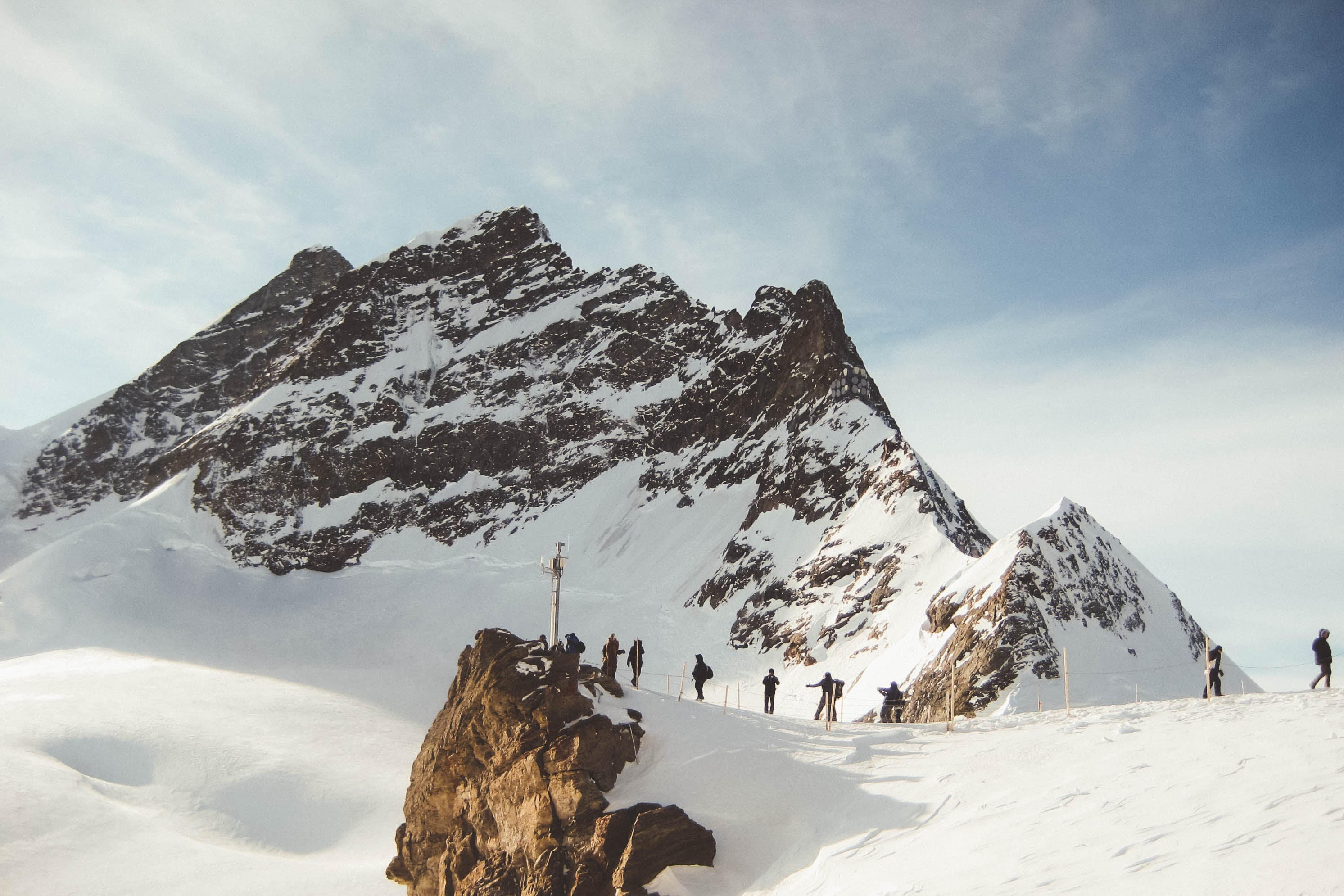 People Walking on Snowy Mountain