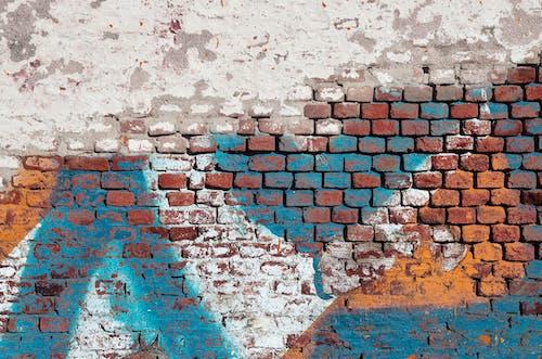 Бесплатное стоковое фото с граффити, кирпич, кирпичная стена