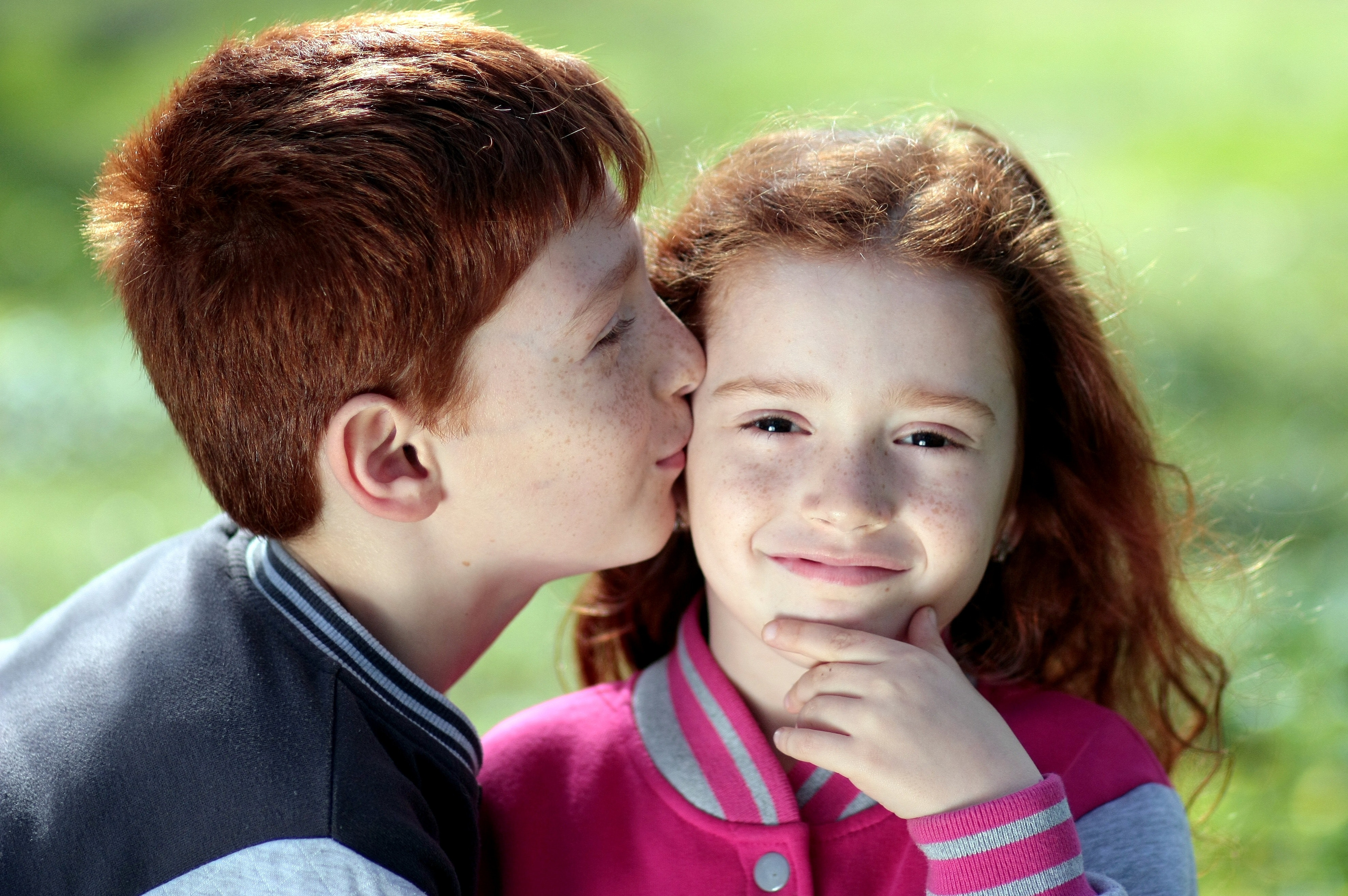 Young Boy Kissing Girl Free Stock Photo