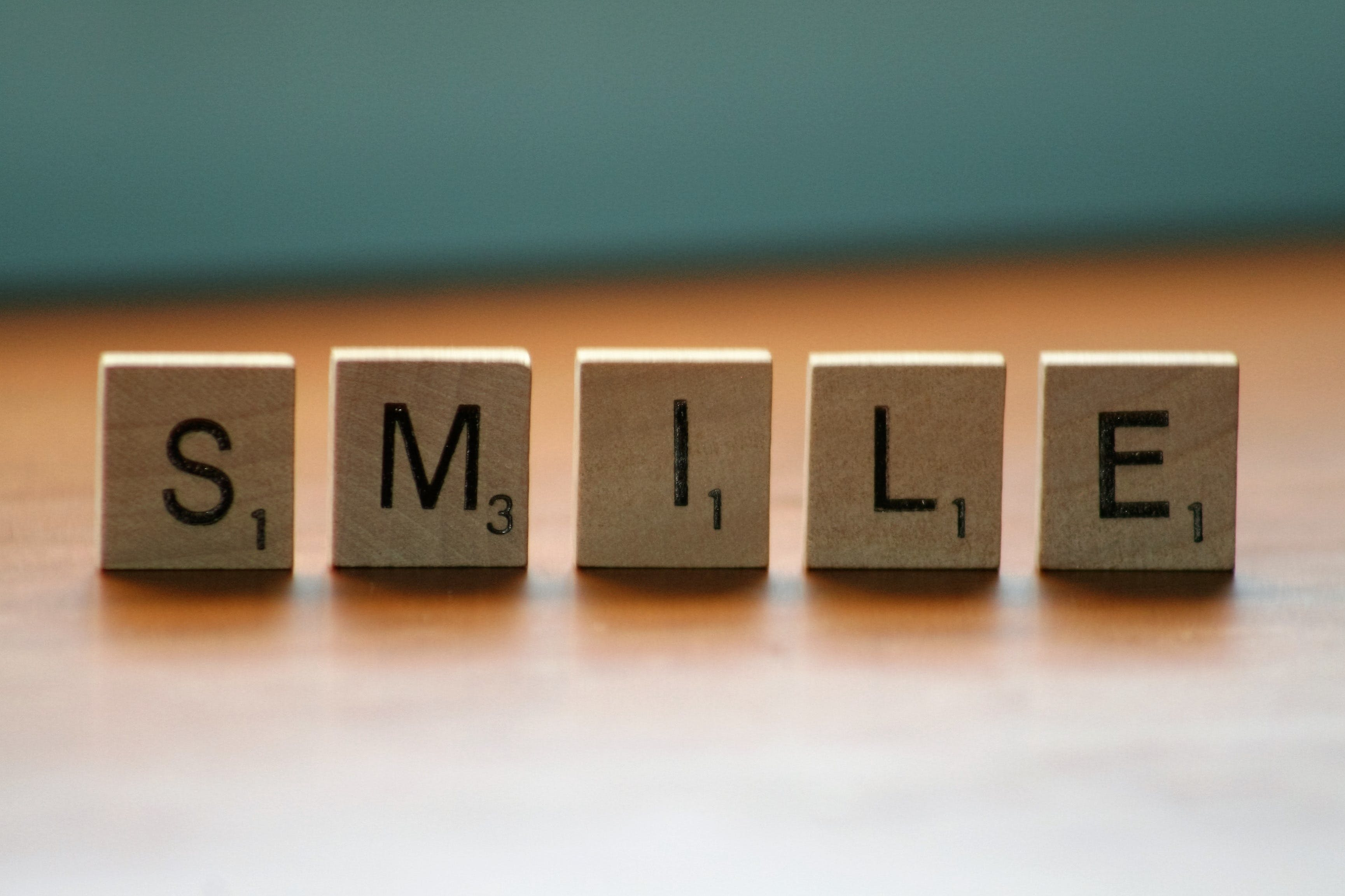 Close Up Photography of Wooden Blocks With Smile Text