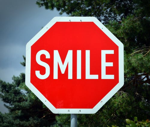 Red and White Smile Signage