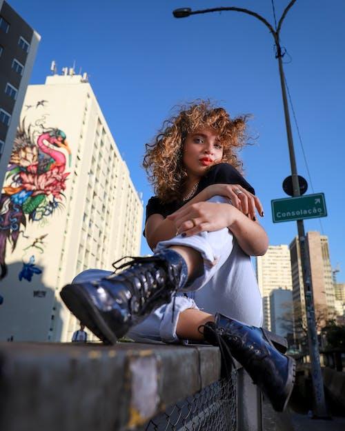 Low Angle Photo Woman Sitting on Metal Railing Posing