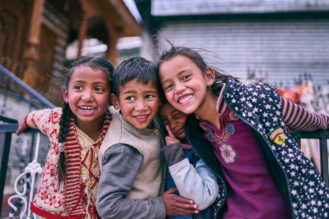 Four children posing for a photo