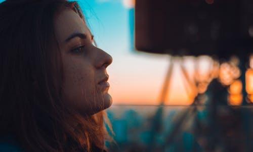 Free stock photo of side, sunset, watching, woman