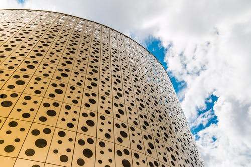 Low Angle Photo of Building With Holes Design