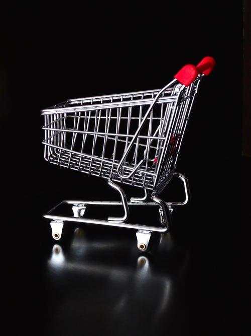 Red Handle Gray Shopping Cart on Black Background