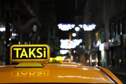 Taksi Vehicle Between Buildings