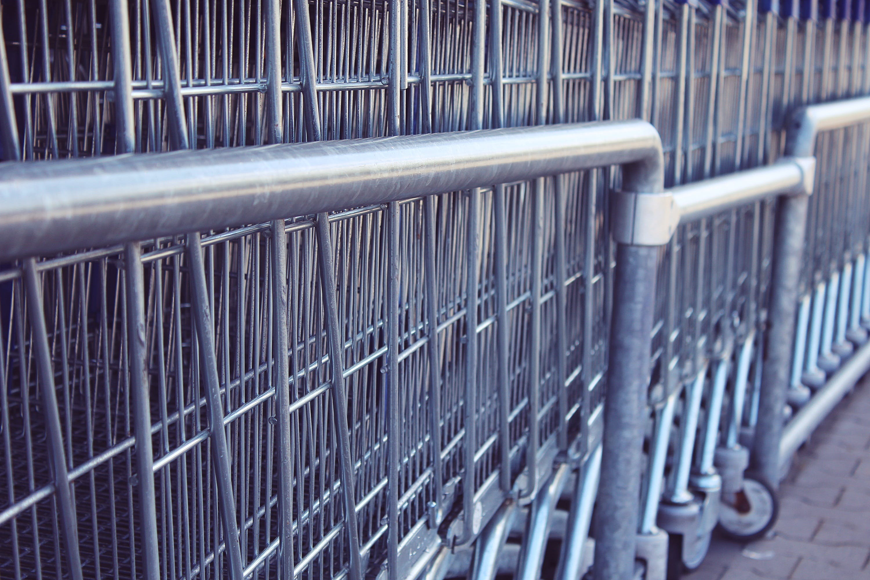 Closeup Photography of Gray Metal Shopping Carts