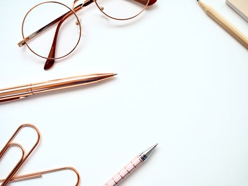 Twist Pen Beside Eyeglasses