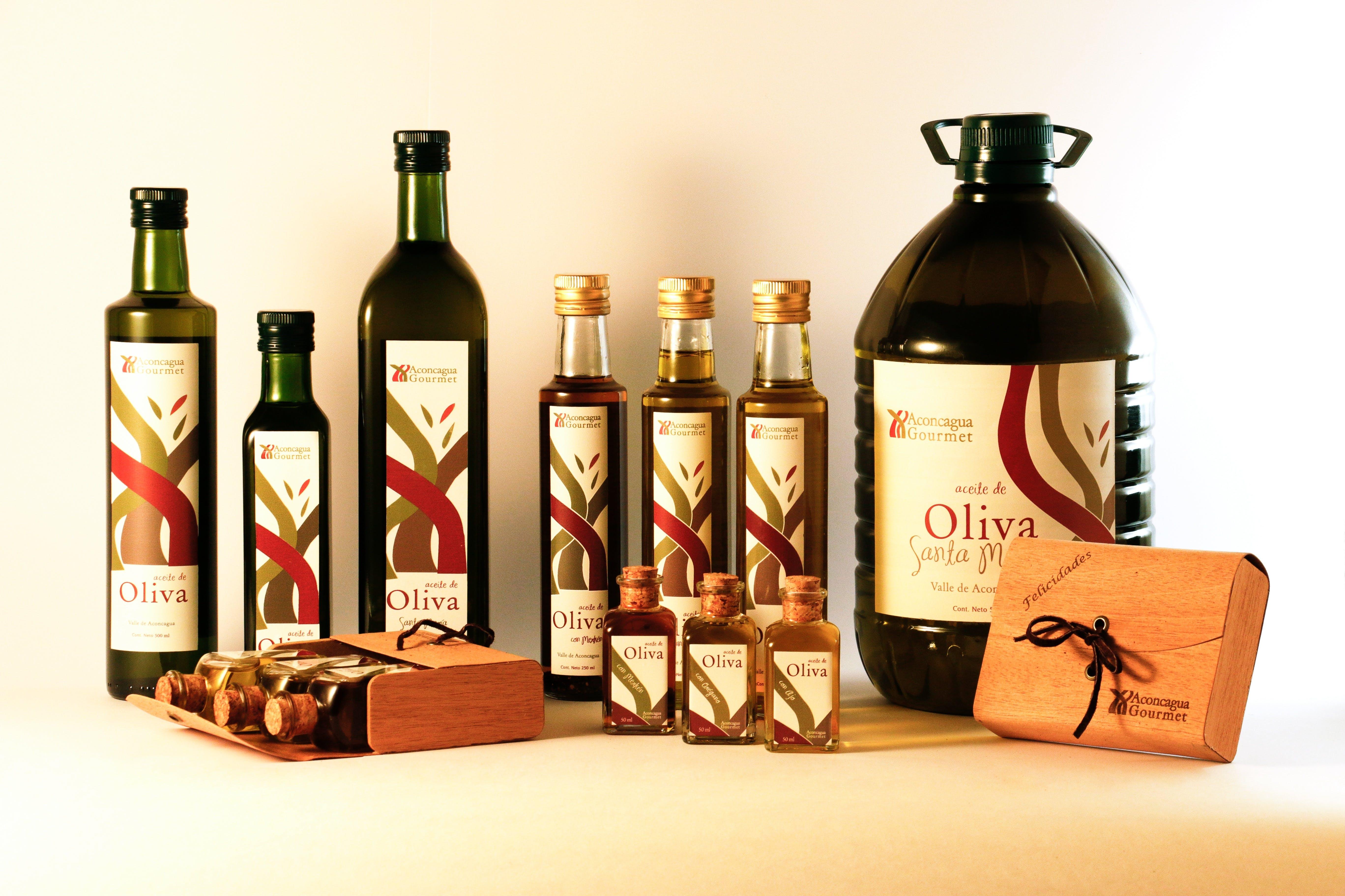 Assorted Bottles on White Table