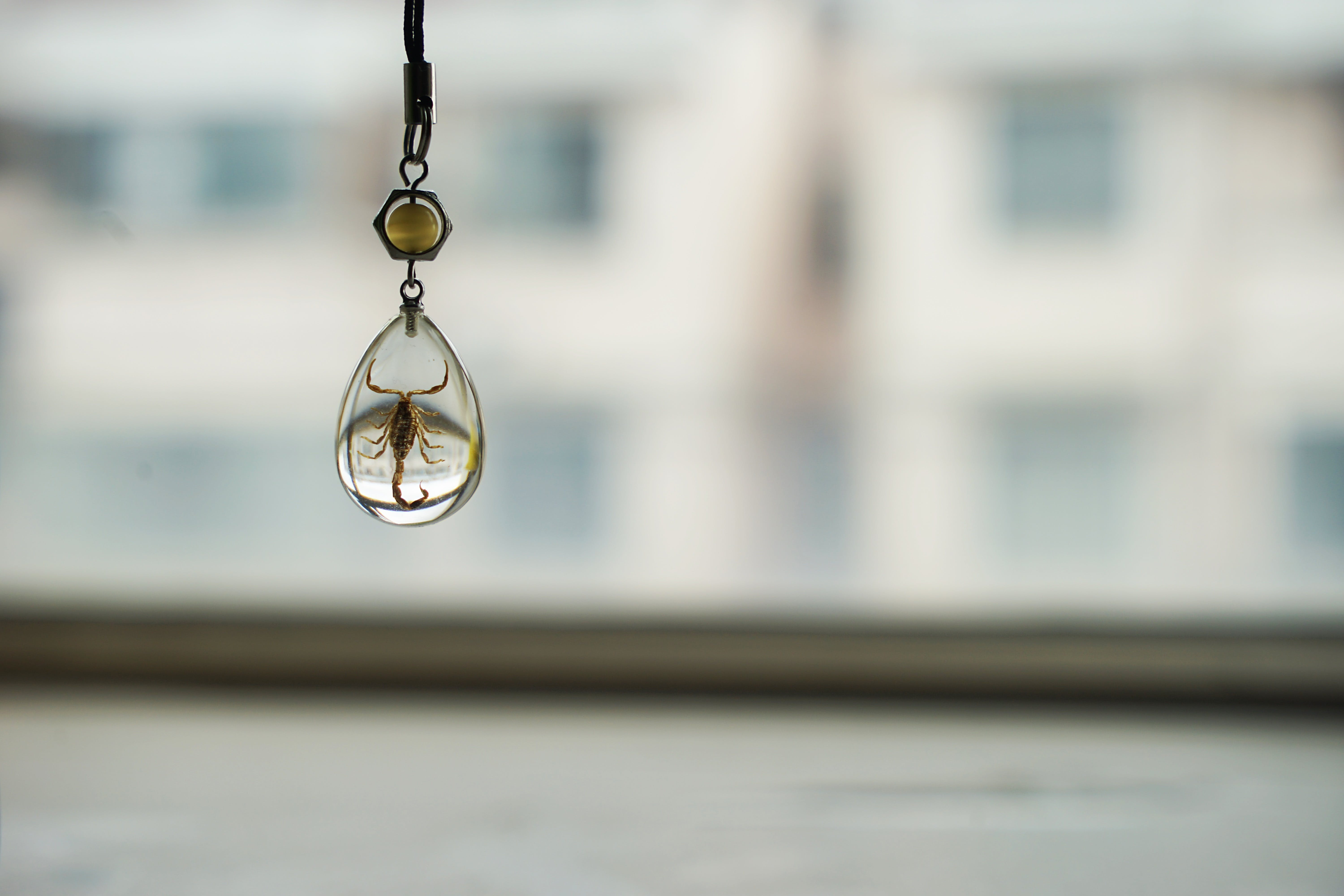 Selective Focus Photography of Glass Hanging Decor
