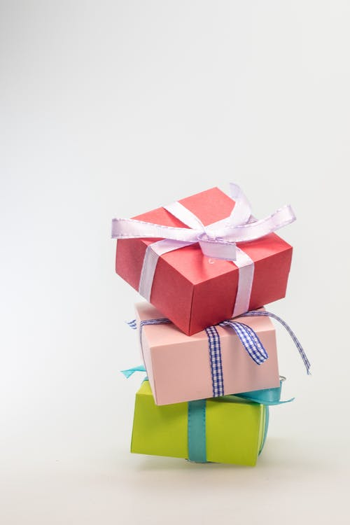 Three Stacked Gift Boxes With Different Colors