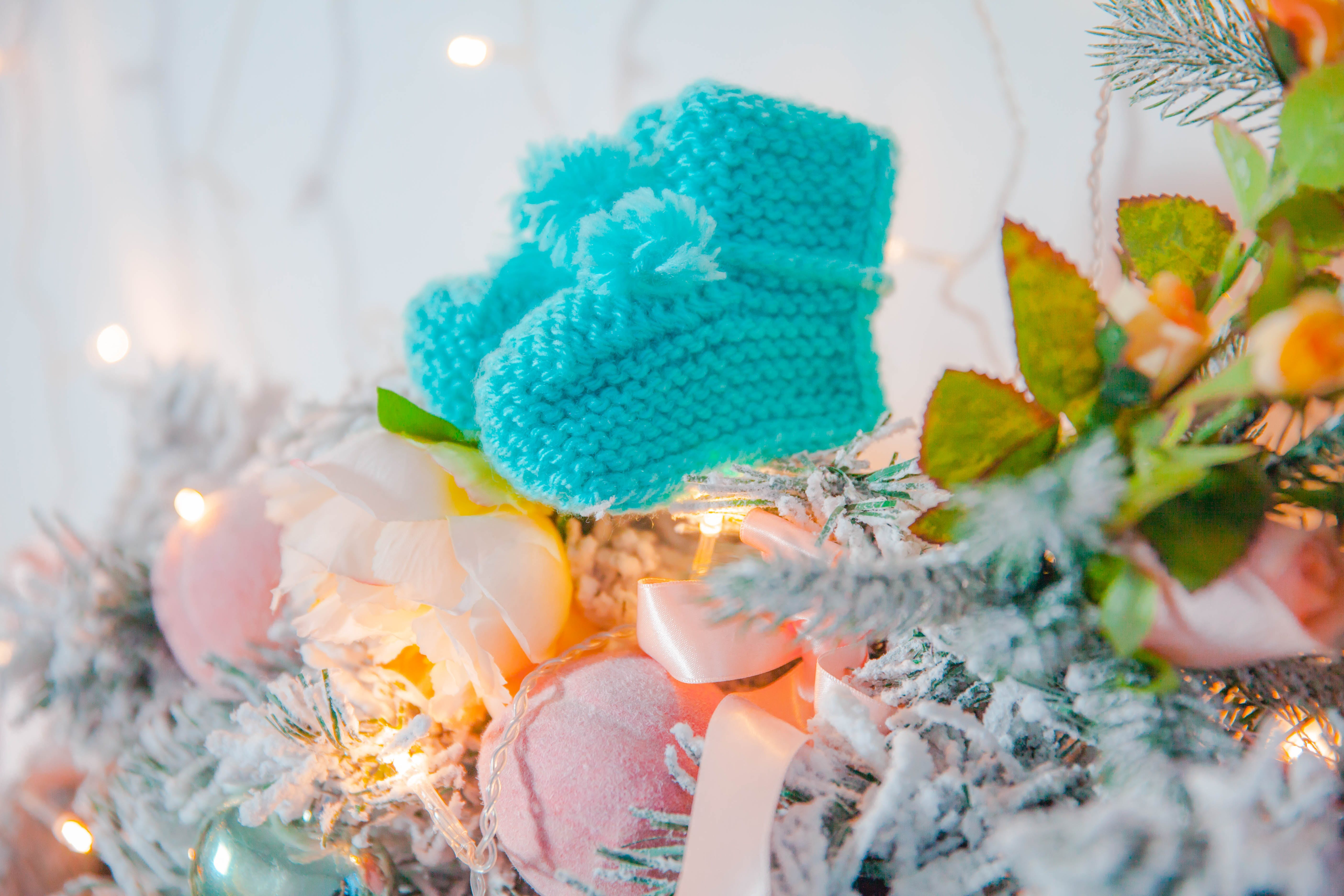 Pair of Teal Knit Sock Hanging on Christmas Tree