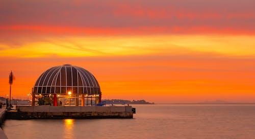 altın rengi Güneş, deniz içeren Ücretsiz stok fotoğraf