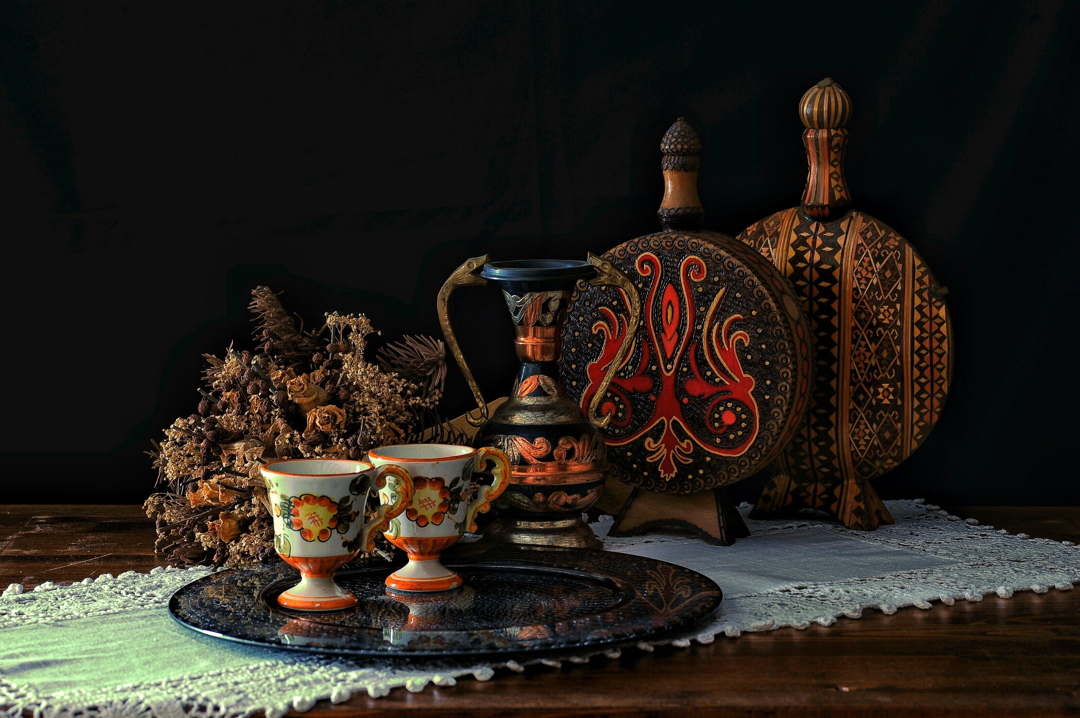 Two White Teacups on Black Tray