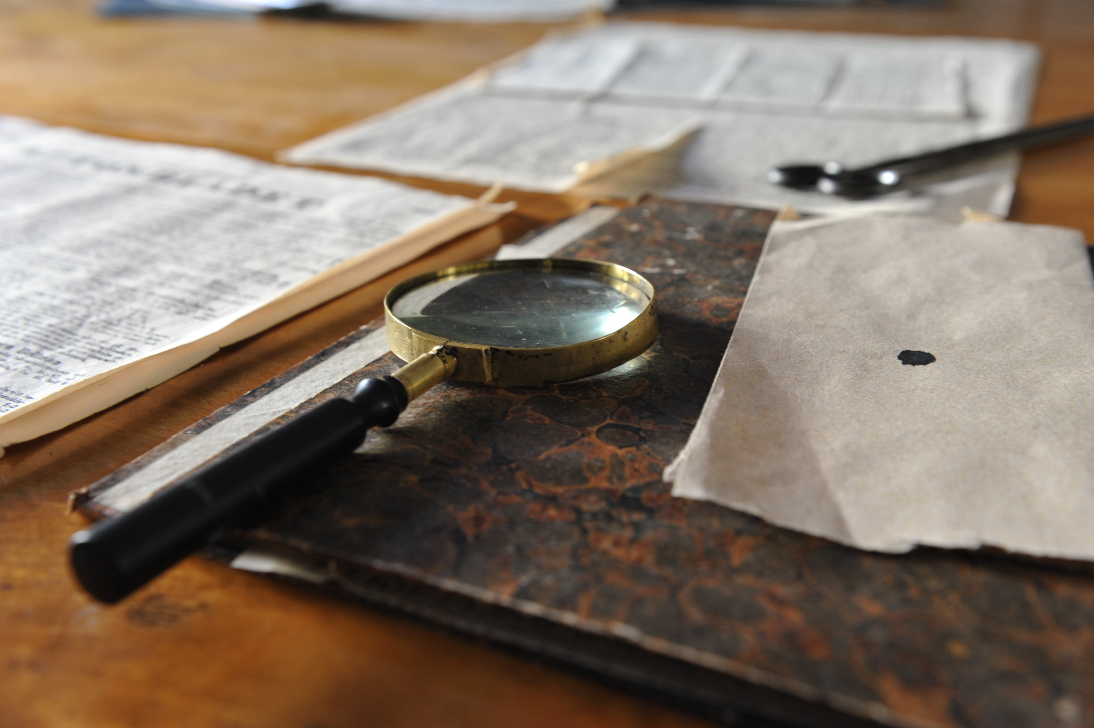 Free stock photo of desk, magnifying glass, map, sheet