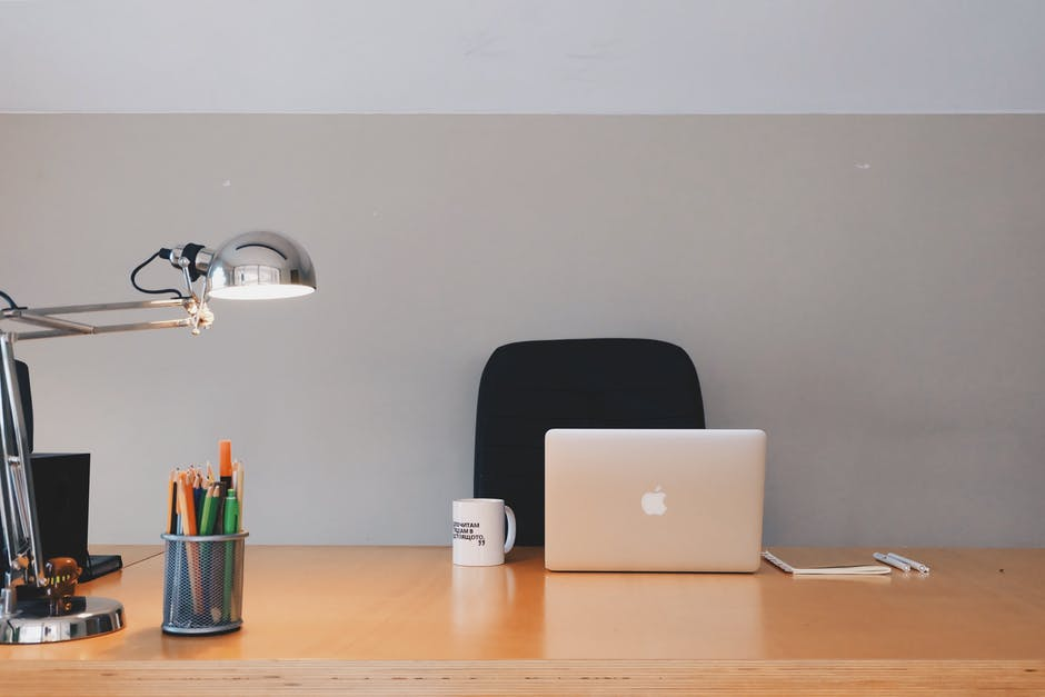 Contemporary Business Desk with Coffee, laptop and lamp