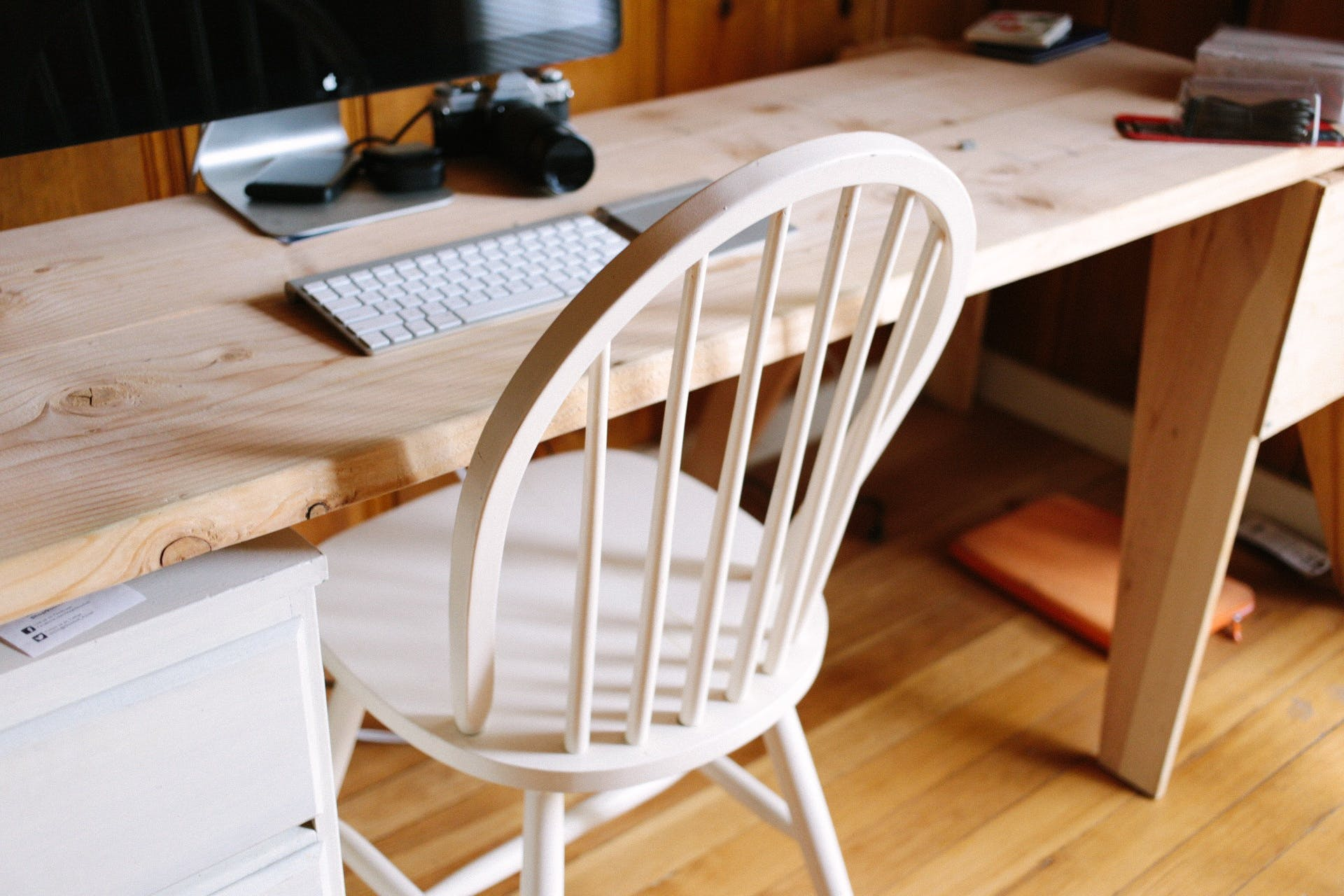 White Wooden Chair Beside Table