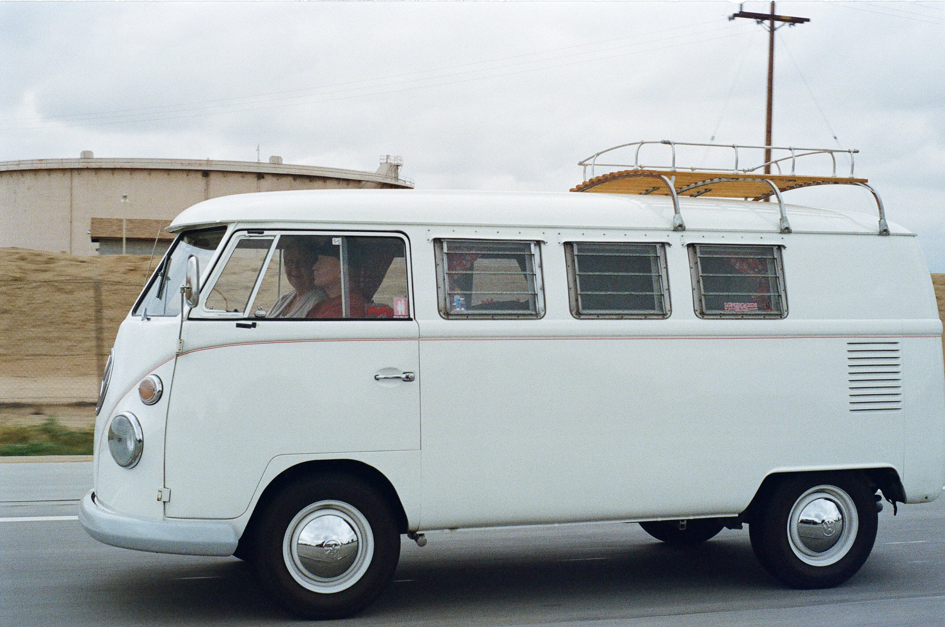 Two Person Riding White Volkswagen T2